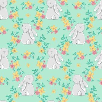 Бесшовный фон с кроликом и цветами.