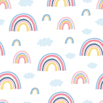 Seamless pattern with rainbow, clouds and hand letters focus on the good for kids