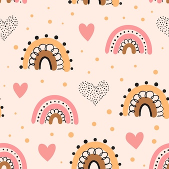 Seamless pattern with rainbow, hearts  in the sky.
