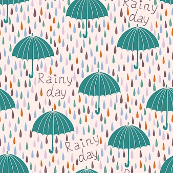 Seamless pattern with raindrops and umbrellas. spring background