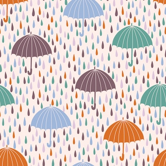 Seamless pattern with raindrops and umbrellas