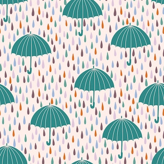 Seamless pattern with raindrops and umbrellas.