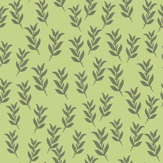 ランダムな小さな葉の枝を持つシームレスなパターン。