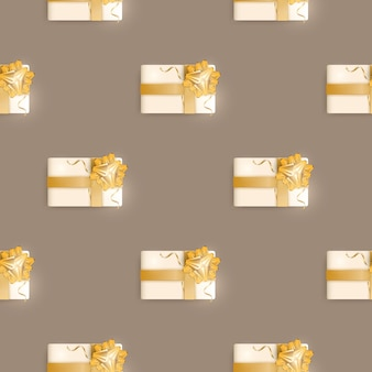 Seamless pattern with realistic gifts. endless background. champagne color. suitable for postcards, prints, brown paper and backgrounds. vector illustration.