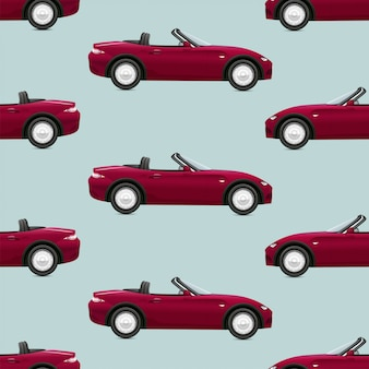 Seamless pattern with red cabriolet cars on green background