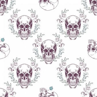 Seamless pattern with skulls and flowers on a white background.