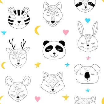 眠っている動物と白い背景の上のシームレスなパターン。