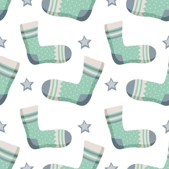 Бесшовный узор с носками звездами и разным принтом зимний модный фон предметов одежды gif ...