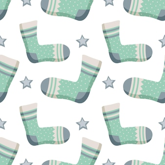 Seamless pattern with socks stars and different print winter trendy background of clothing items gif...