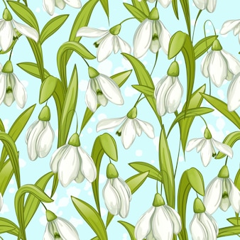 Seamless  pattern with spring snowdrops on a blue background.
