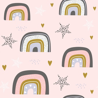 Seamless pattern with stars and rainbow in the sky.