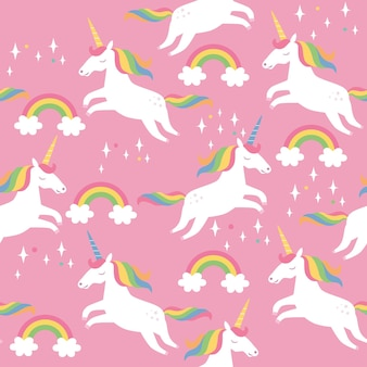 Seamless pattern with stars rainbows and unicorns on pink background vector illustration