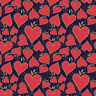イチゴとハート型の葉のシームレスなパターン。暗い背景の上のベクトル画像。 eps10。