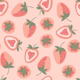 落書きスタイルのベクトルでピンクの背景にイチゴとシームレスなパターン