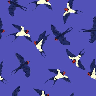 Seamless pattern with swallows on a blue background.
