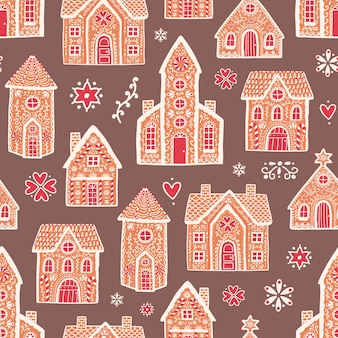Seamless pattern with sweet delicious gingerbread houses and decorated with sugar icing