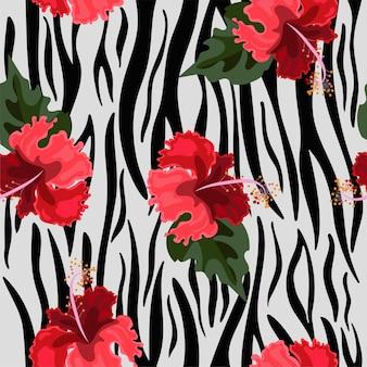 虎の皮とハイビスカスの花のシームレスなパターン。