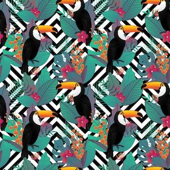 トウカンの鳥と熱帯の葉とシームレスなパターン