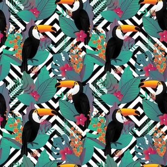Seamless pattern with toucan bird and tropical leaves