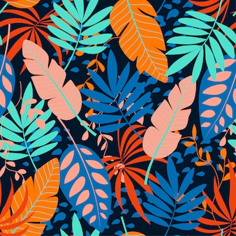 Seamless pattern with tropical blue leaves on dark background
