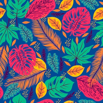 Seamless pattern with tropical leaves on a blue background.  graphics.