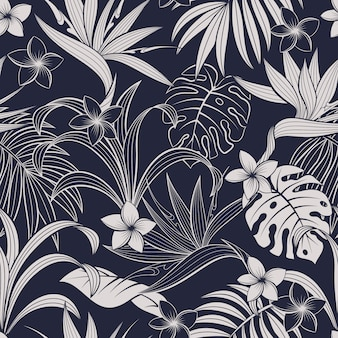 Seamless pattern with tropical leaves and flowers. elegant dark blue and white exotic background.