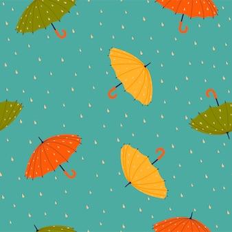 傘とドロップとのシームレスなパターン。ベクトルグラフィックス。