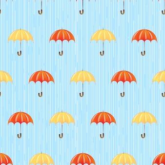 雨の中で傘を持つシームレスパターン