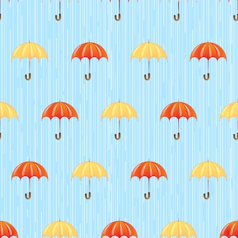 Seamless pattern with umbrellas in the rain