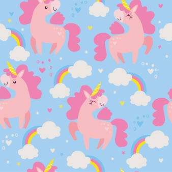 Seamless pattern with unicorns and rainbows on blue background