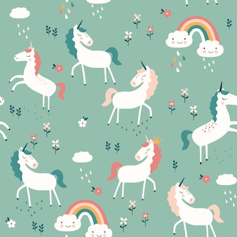 Seamless pattern with unicorns, rainbows and flowers on blue background.