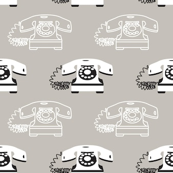 Seamless pattern with vintage telephones on gray background.