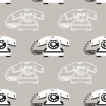 灰色の背景にビンテージ電話とのシームレスなパターン。