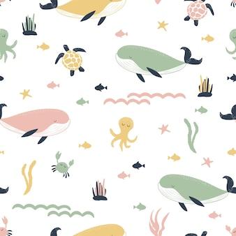 고래, 문어, 바다 거북, 보헤미안 스타일의 물고기와 함께 매끄러운 패턴입니다. 파스텔 색조. 수중 세계 배경입니다.