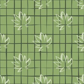 緑の市松模様の背景に白いアウトライン大麻葉のシームレスパターン