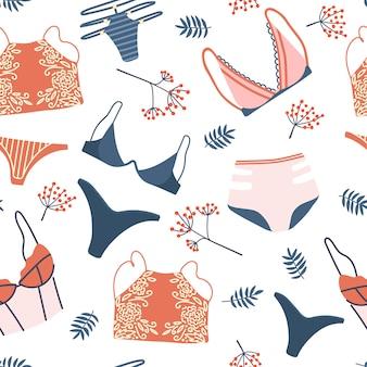 女性のランジェリーと下着とのシームレスなパターン。スタイリッシュなブラ、パンティー、ビキニの背景。テキスタイル、tシャツ、包装紙の手描きのパターン。キュートなフェミニンな下着セット。