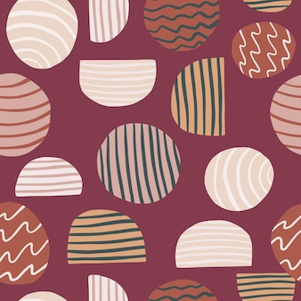 Seamless patttern with abstract elements. circles and halfs ornament on soft maroon background.