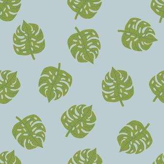 緑の手描きのモンステラ飾りとのシームレスなランダムパターン。