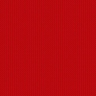 シームレスな赤いニットの背景。
