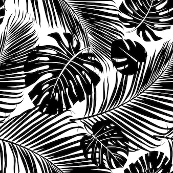 Seamless repeating pattern with silhouettes of palm tree leaves in black on white backgrou