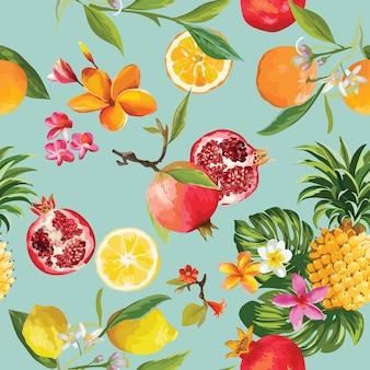 シームレスなトロピカルフルーツのパターン。ザクロ、レモン、オレンジ色の花、葉、果物の背景。