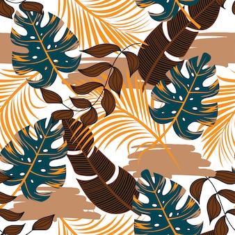 Бесшовный тропический узор с ярко-синими и коричневыми листьями и растениями