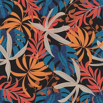 Бесшовный тропический узор с яркими листьями и растениями