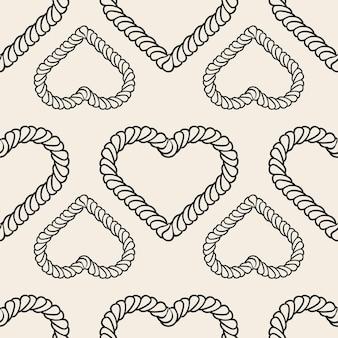 Бесшовный фон образца дня святого валентина с монохромным сердцем из классической веревки