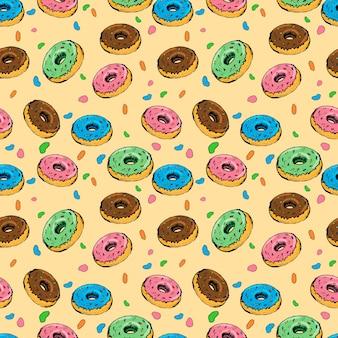 Бесшовные векторные фон с красочными пончиками