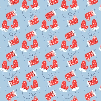 Seamless vector pattern of christmas mittens and socks. christmas gift blue background