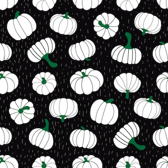 Seamless vector pattern of pumpkins  on a black background