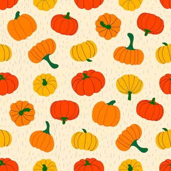 Seamless vector pattern of ripe pumpkins and stripes on a beige background