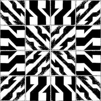 Seamless vector pattern with pencil style in black and white square tiles.