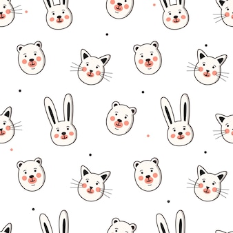 Seamless vector pattern with smiling animal faces.